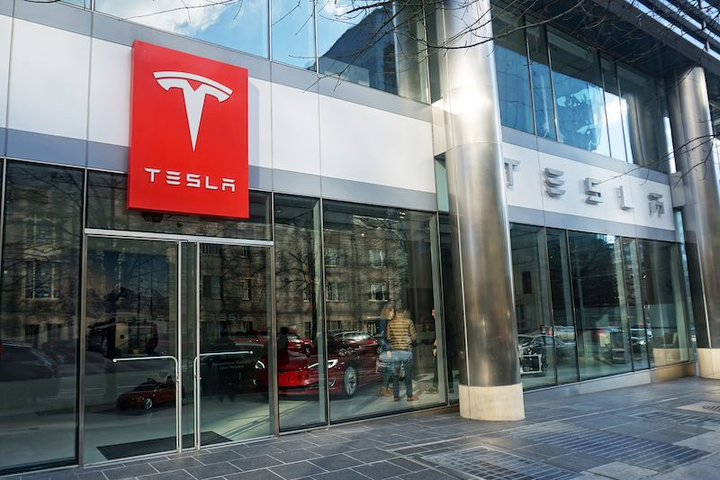 Tesla to raise prices, backtracks on closing most stores