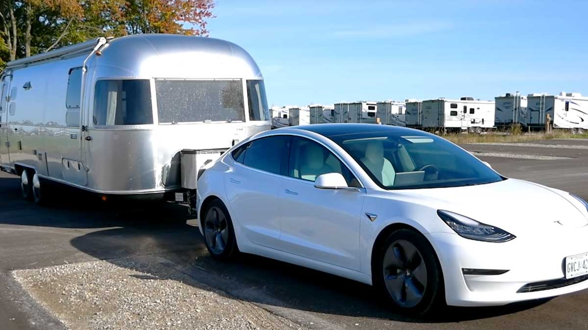 model 3 pulling airstream caravan